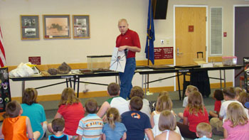 SWAT Experts Teach Elementary Schoolers About Insects